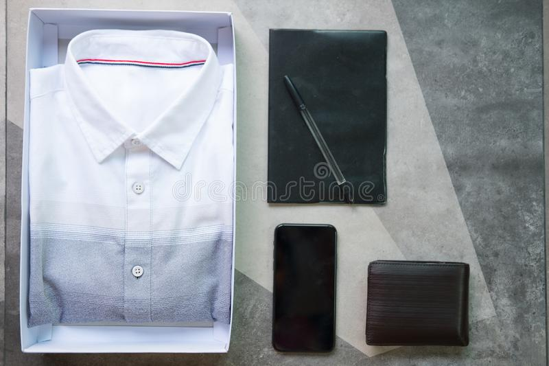 Flat lay composition with classic mens clothes and accessories. Wallet, watch,mobile phone, book and pen royalty free stock photo