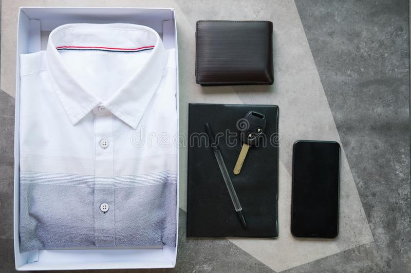 Flat lay composition with classic mens clothes and accessories. Wallet, watch,mobile phone, car key stock photo