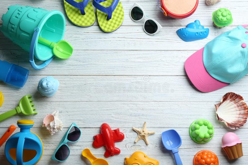 Flat lay composition with colorful beach toys on wooden background royalty free stock photos
