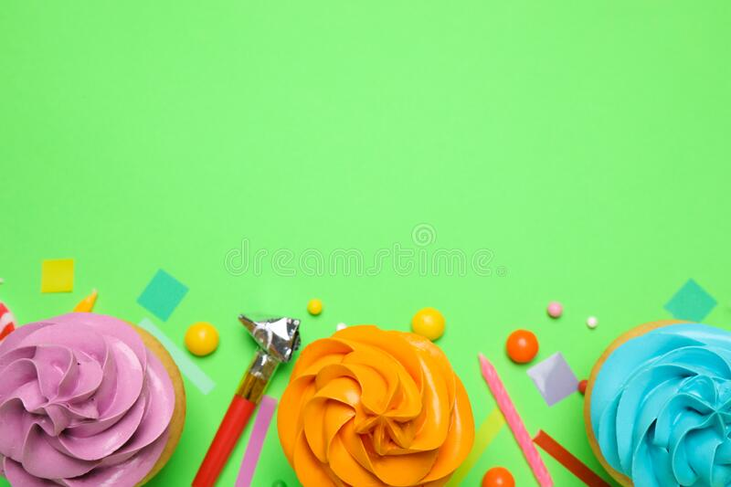 Flat lay composition with colorful birthday cupcakes on background. Space for text stock image