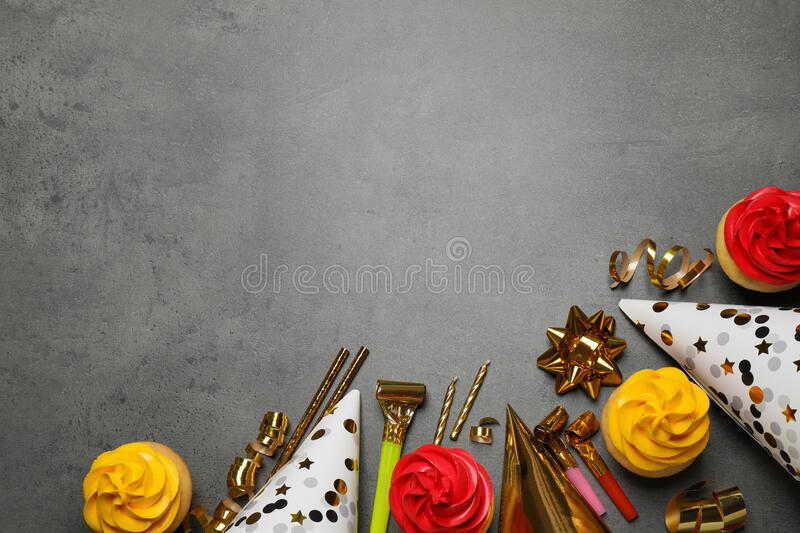 Flat lay composition with colorful birthday cupcakes on table. Space for text royalty free stock images