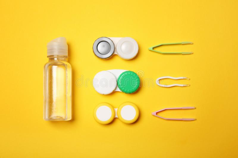 Flat lay composition with contact lens accessories. On color background stock photos