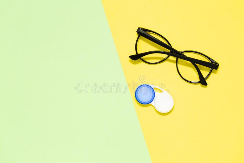 Flat lay composition with contact lenses and glasses stock photography