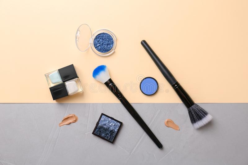 Flat lay composition with cosmetic products on color background royalty free stock photography
