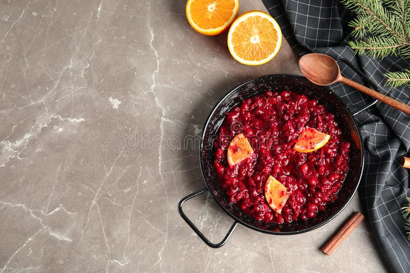 Flat lay composition with cranberry sauce in pan on table. Space for text royalty free stock photography