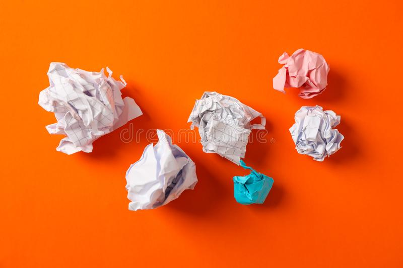 Flat lay composition with crumpled paper balls on color background royalty free stock photography