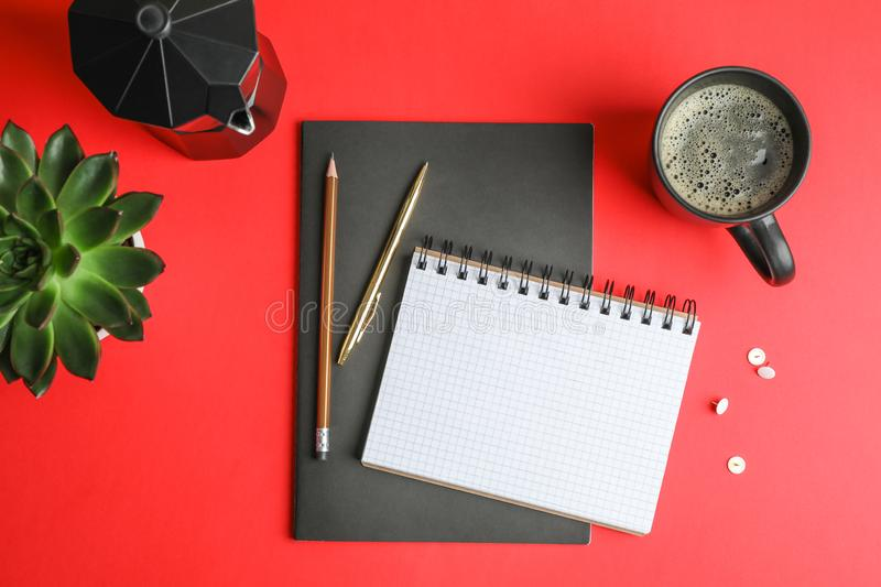 Flat lay composition with cup of coffee, copybooks, pencils and succulent plant stock photo