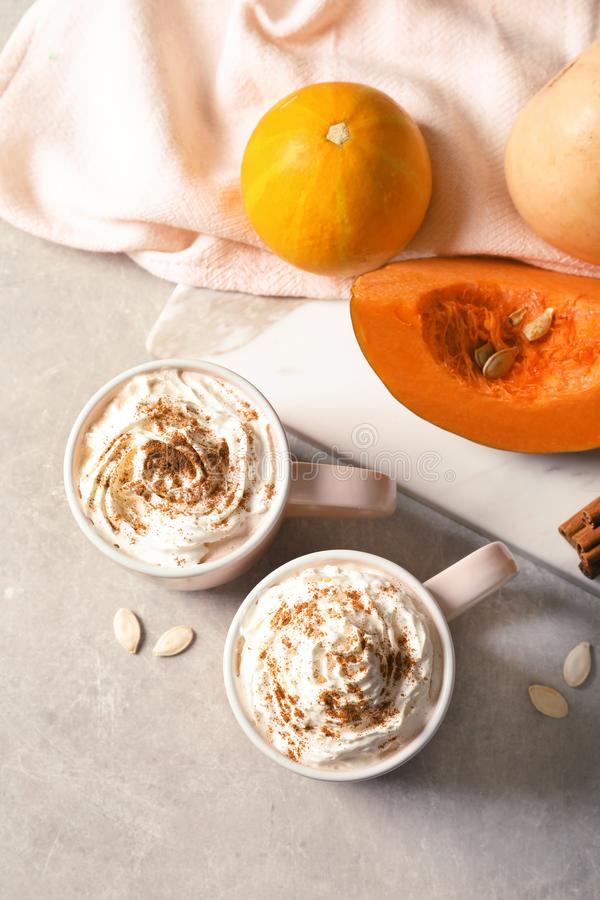Flat lay composition with cups of tasty pumpkin spice latte royalty free stock images