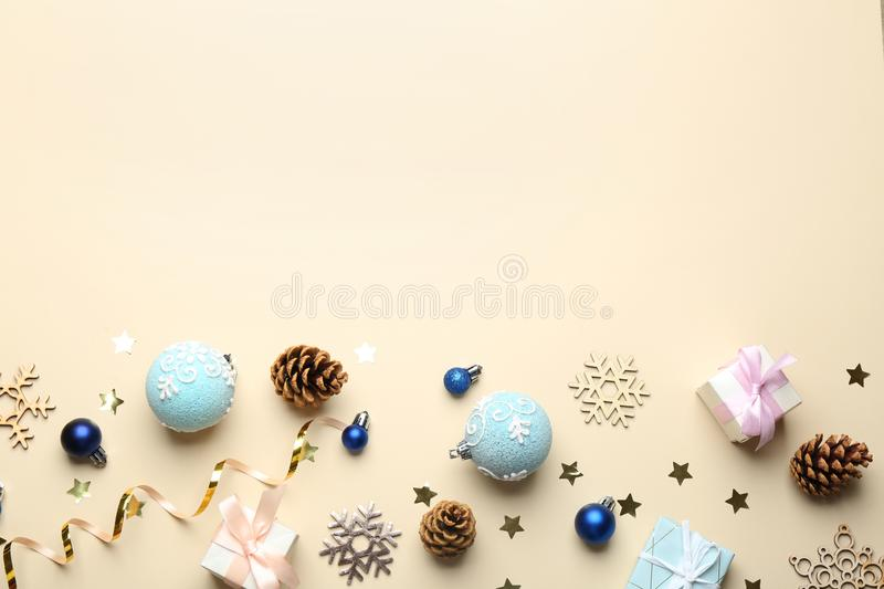 Flat lay composition with  decorations on beige background, space for text. Winter season. Flat lay composition with Christmas decorations on beige background royalty free stock images