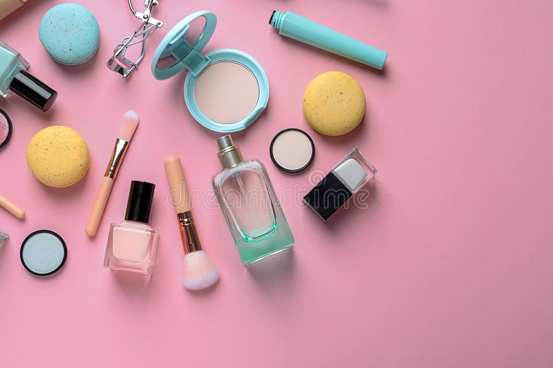 Flat lay composition with decorative cosmetics. On color background stock photos