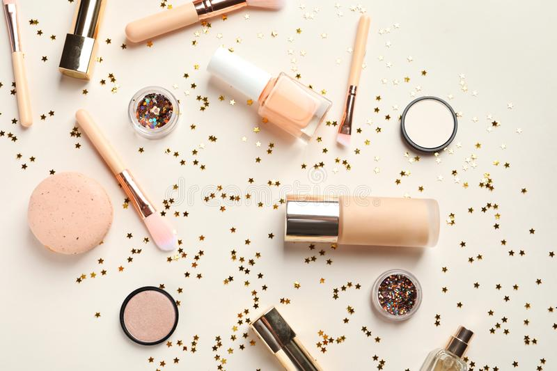 Flat lay composition with decorative cosmetics. On color background royalty free stock images