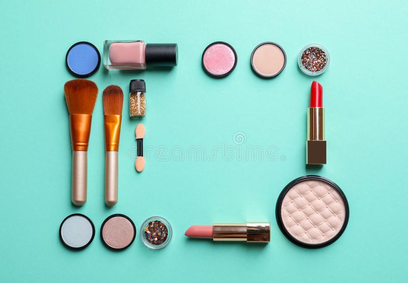 Flat lay composition with decorative cosmetics. On color background stock photo