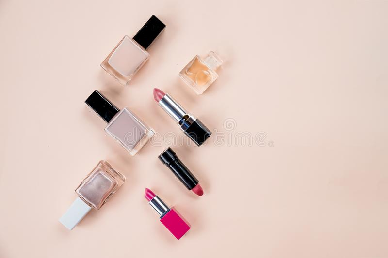 Flat lay composition with decorative cosmetics on pastel background.Beauty concept. Top view.professional makeup. Bottle stock photo