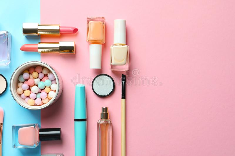 Flat lay composition with decorative cosmetics. On color background stock images