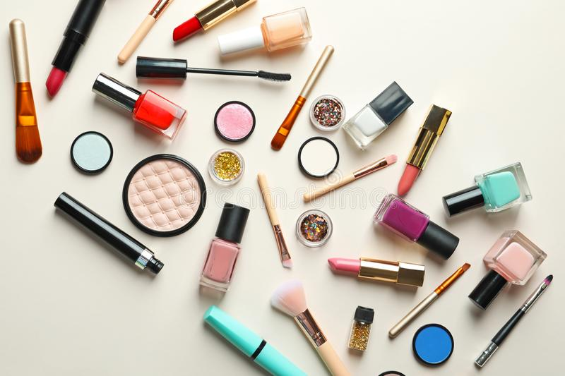 Flat lay composition with decorative cosmetics. On color background stock image