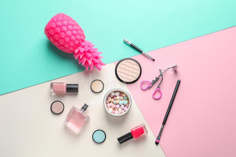 Flat lay composition with decorative cosmetics. On color background stock photography
