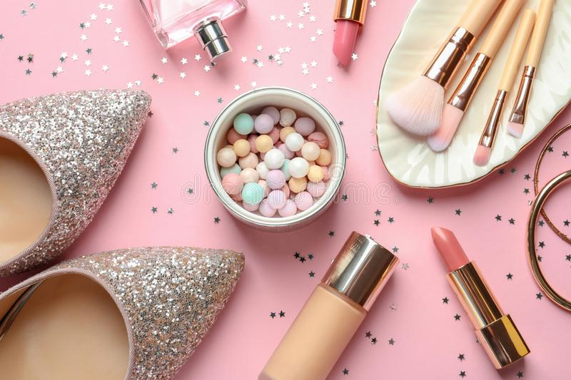 Flat lay composition with decorative cosmetics. On color background royalty free stock photos