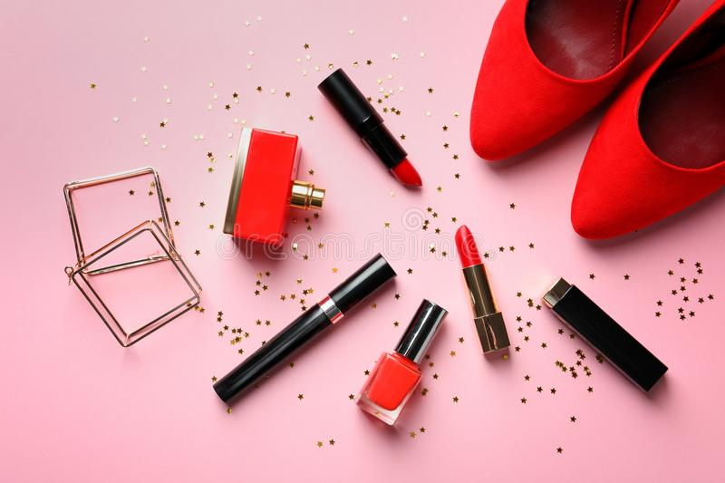 Flat lay composition with decorative cosmetics. On color background royalty free stock image