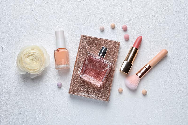Flat lay composition with decorative cosmetics. On light background stock photography