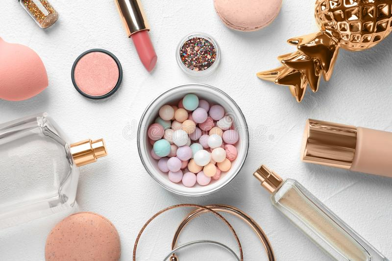 Flat lay composition with decorative cosmetics. On light background stock photo