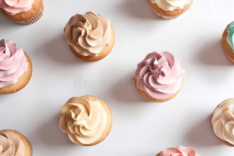 Flat lay composition with delicious birthday cupcakes. On white background stock photo