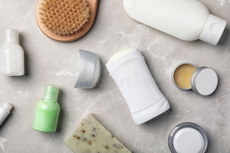 Flat lay composition with deodorant and toiletries. On grey background stock image