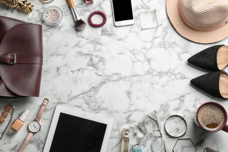 Flat lay composition with devices, blogger`s stuff  on marble background. Flat lay composition with devices, blogger`s stuff and space for text on marble stock images