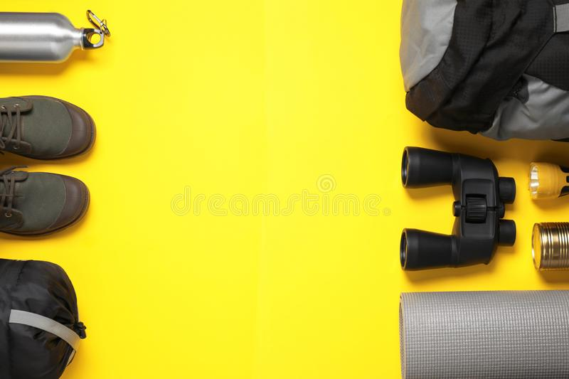 Flat lay composition with different camping equipment on color background. Space for text royalty free stock image