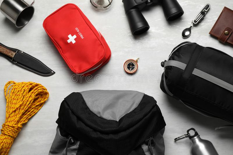 Flat lay composition with different camping equipment. On light background royalty free stock photo