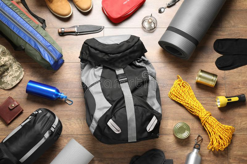 Flat lay composition with different camping equipment. On wooden background royalty free stock photos