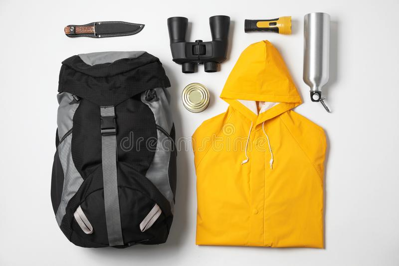 Flat lay composition with different camping equipment on white. Background stock photography