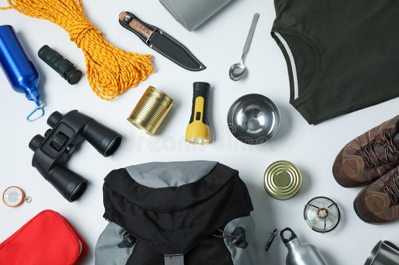 Flat lay composition with different camping equipment on white. Background stock photos