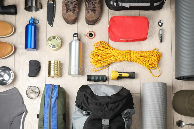 Flat lay composition with different camping equipment. On wooden background royalty free stock photography