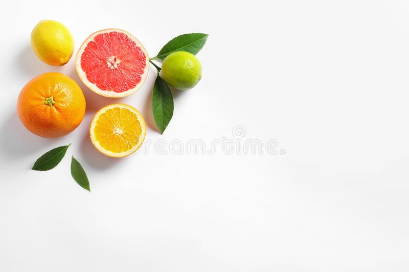 Flat lay composition with different citrus fruits on white. Background stock photography