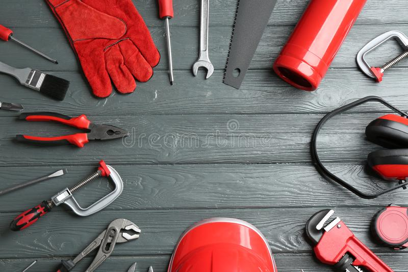 Flat lay composition with construction tools and space for text on wooden background royalty free stock photo