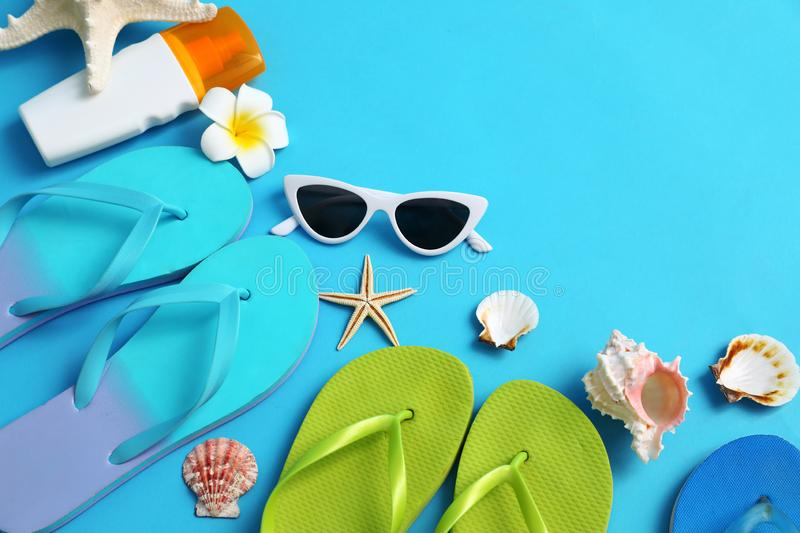 Flat lay composition with different flip flops on blue background. Summer beach accessories. Flat lay composition with different flip flops on blue background royalty free stock photos