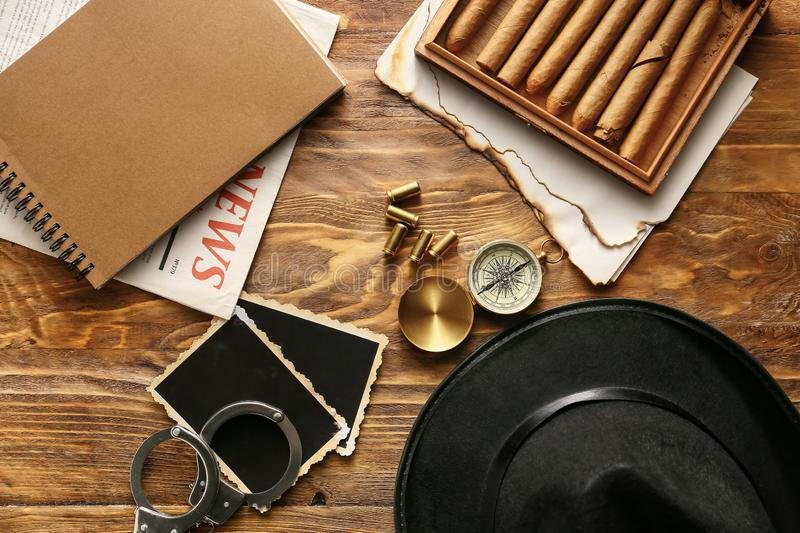 Flat lay composition with different items for detective on wooden background stock photos