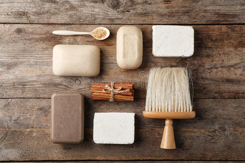 Flat lay composition with different soap bars. On wooden background royalty free stock image