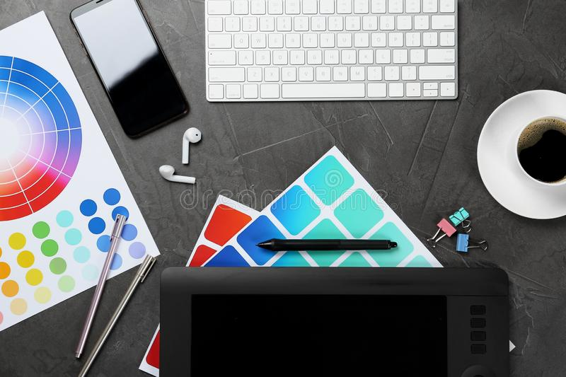 Flat lay composition with digital devices and color palettes on background. Graphic designer`s workplace. Flat lay composition with digital devices and color stock photo