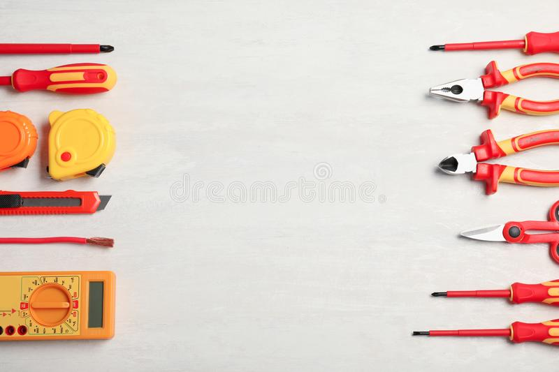 Flat lay composition with electrician`s tools and space for text stock images