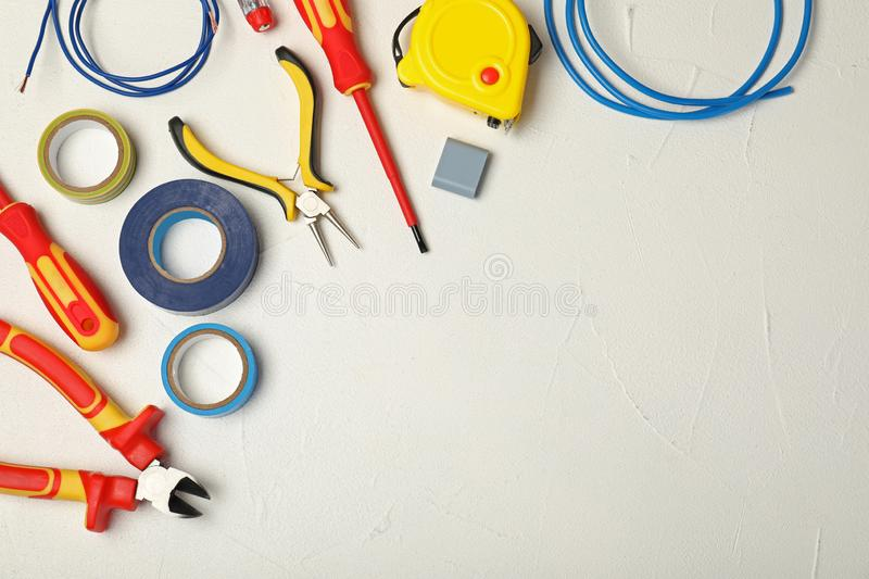 Flat lay composition with electrician`s tools and space for text royalty free stock image