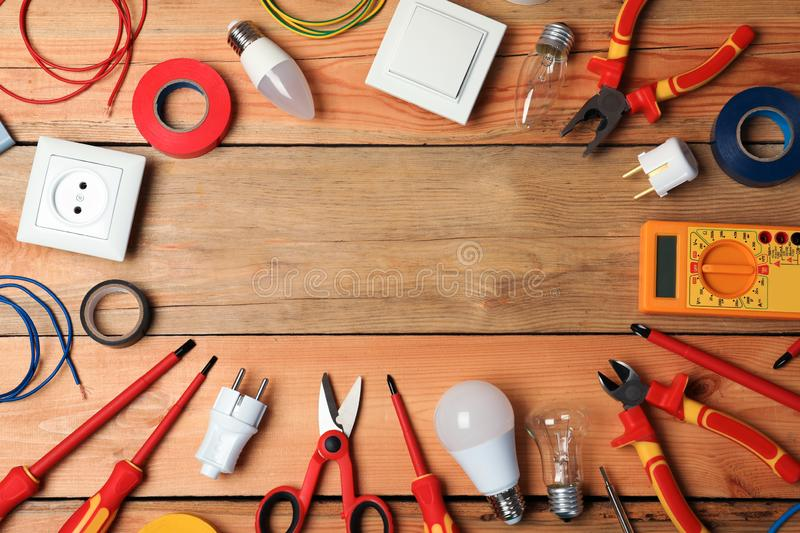 Flat lay composition with electrician`s tools and space for text. On wooden background royalty free stock photos