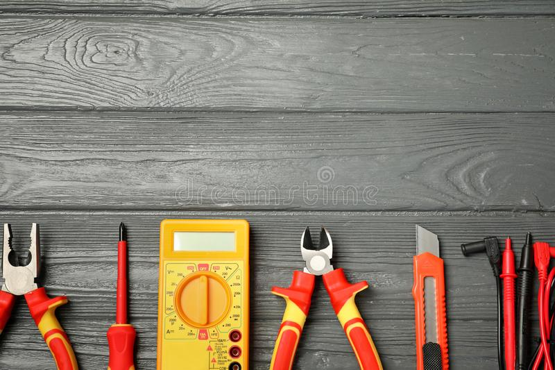 Flat lay composition with electrician`s tools and space for text. On wooden background royalty free stock images