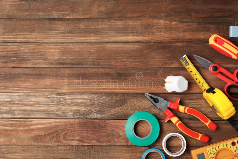Flat lay composition with electrician`s tools and space for text stock photos