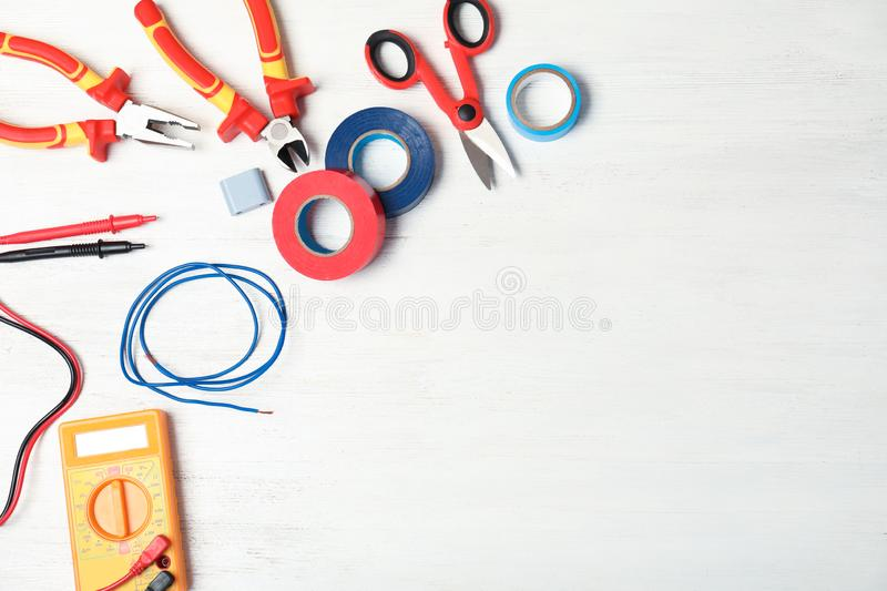 Flat lay composition with electrician`s tools stock image