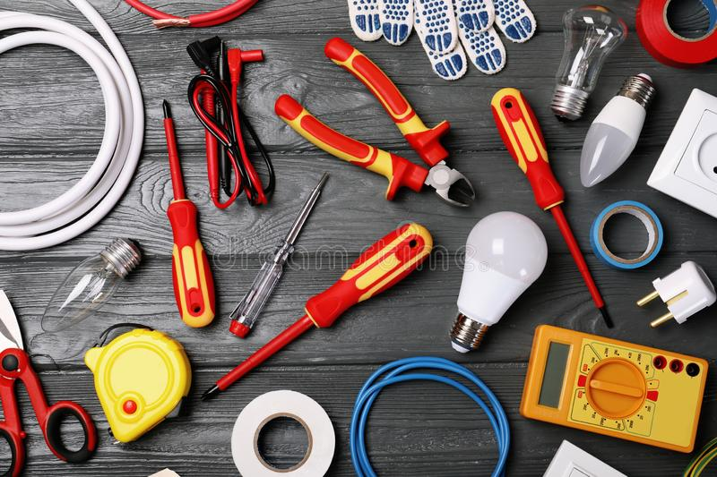 Flat lay composition with electrician`s tools. On wooden background stock photos