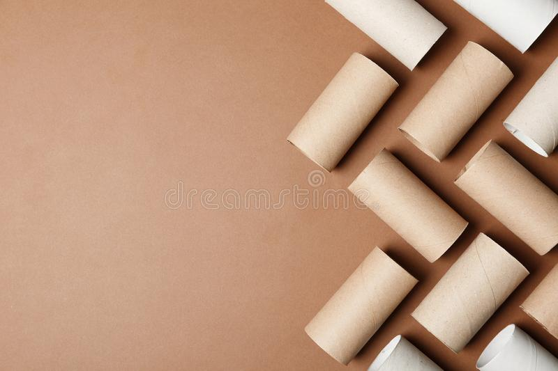 Flat lay composition with empty toilet paper rolls and space for text. On color background stock images