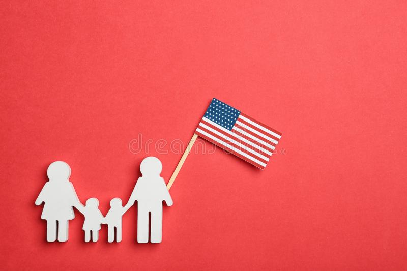 Flat lay composition of family figure with USA flag. Happy Independence Day. Flat lay composition of family figure with USA flag on color background. Happy royalty free stock photography