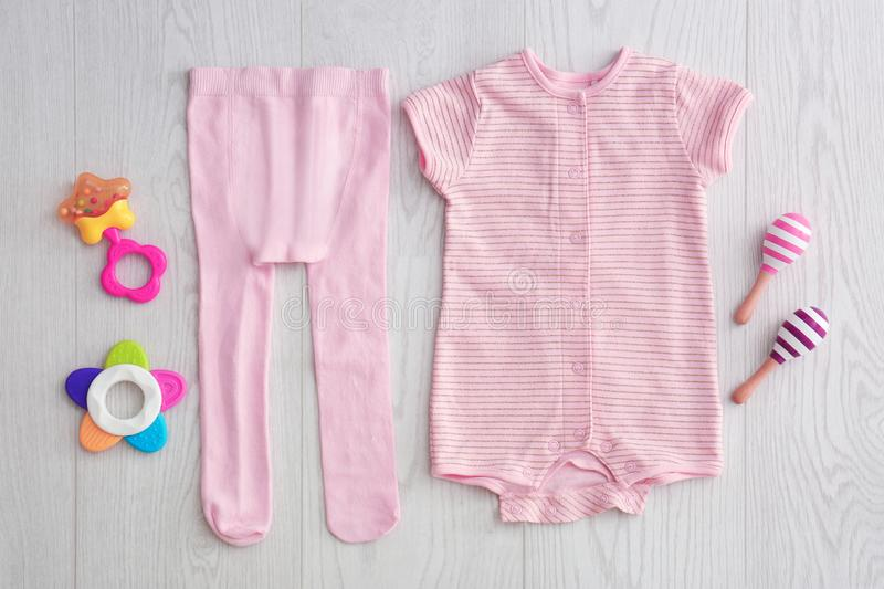 Flat lay composition with fashionable children`s clothes. On wooden background royalty free stock photo