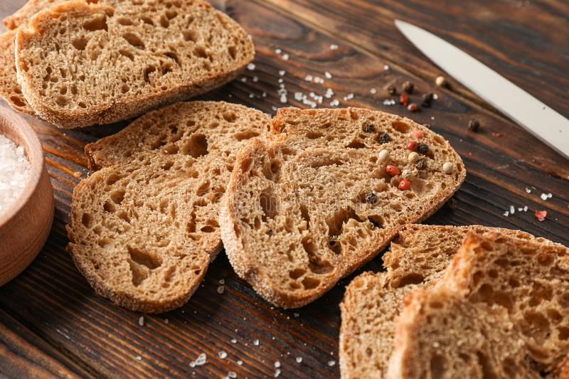 Flat lay composition with freshly baked bread on wooden background, closeup stock image